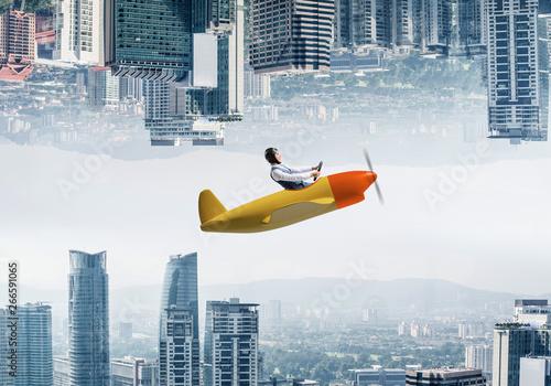 Fototapeta  Businessman flying in small airplane
