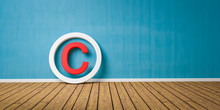 Red Copyright Symbol On Wodden Floor Lean On Blue Grunge Wall With Copy Space - 3D-Illustration