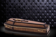 Closed Wooden Brown Coffin Wit...