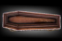 Closed Wooden Brown Coffin Cov...
