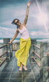 Happy woman moving arms to the wind over the sea - 266606490