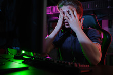 Professional Young Caucasian Gamer Playing Online On His PC. He Upset Because Of Losing The Game