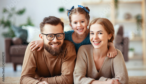Garden Poster Akt happy family mother father and child daughter laughing at home .