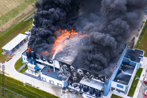 Fotografie, Tablou Aerial view of burnt industrial warehouse or logistics center building after big