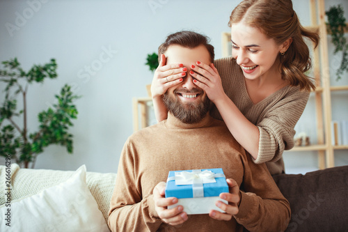Fotografia, Obraz Happy married couple man and woman give a gift for holiday      .