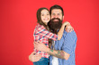 Leinwanddruck Bild - Celebrate fathers day. Family values concept. Family bonds. Friendly relations. Father hipster and his daughter. Happy moment. Man bearded father and cute little girl daughter on red background