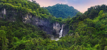 Wonderful Landscape Of Cascade Waterfall In Tropical Rainforest. Scenery Of Rocky Cliff And Cimarinjung Waterfall At UNESCO Global Geopark Ciletuh.