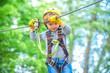 Leinwandbild Motiv Child boy having fun at adventure park. Happy child climbing in the trees. Happy Little child climbing a tree. Balance beam and rope bridges.