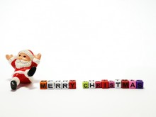Closeup And Macro Shot Of Santa Claus With Merry Christmas Blocks Toy.