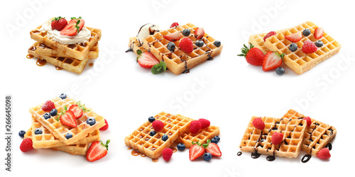 Set of delicious waffles with different toppings on white background