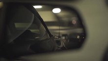 Shot Of A Side Mirror Of A Ford Mustang In Movement During Night Time.