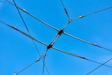 Overhead Trolley Wire Under Blue Sky