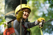Leinwandbild Motiv Climber child on training. Cute little boy in climbing safety equipment in a tree house or in a rope park climbs the rope. Safe Climbing extreme sport with helmet