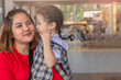Asian Mother and Child smiling and hugging With love on blurred background for lifestyle family joyful happiness image.