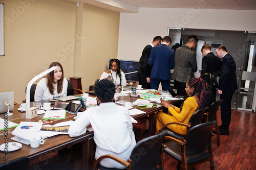 Foto  Diverse business people on a meeting at round table.