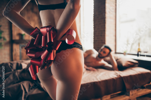 fototapeta na ścianę Romance pervert prostitute two people partners enjoy night. Rear back behind view photo of slim gorgeous fit slender legs hips tights tied hands with red ribbon teasing lace bikini two nude people