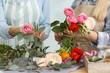 Leinwandbild Motiv Florists making beautiful bouquet at table