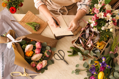 Printed kitchen splashbacks Amsterdam Florist writing in notebook at table