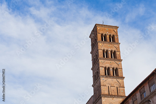 Foto  Tower against blue, cloudy sky