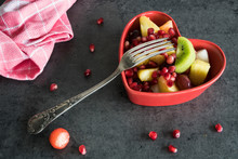 Fruit Salad In Red Heart Shape Bowl, With Fork