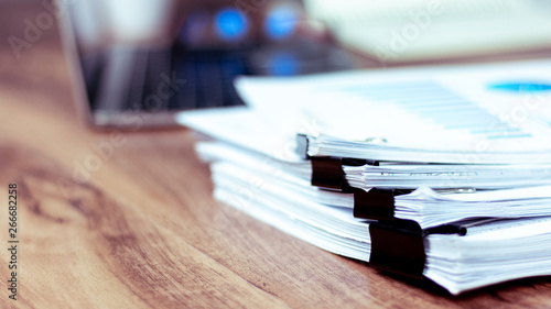 Fototapeta Stack of documents placed on a business desk in a business office. obraz