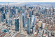 New York City from helicopter point of view. Midtown Manhattan and Hudson Yards on a cloudy day
