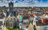 GENT, BELGIUM - MARCH 2015: Tourists visit ancient medieval city. Gent attracts more than 1 million people annually - 266686239