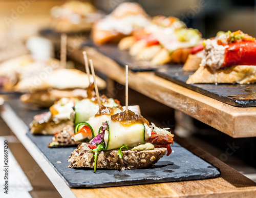 Typical Basque bar with a set of pintxos on a display. Fototapet