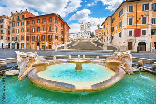 Printed kitchen splashbacks Rome Rome, Italy. Fountain of the Boat (Fontana della Barcaccia) on Spanish square (Piazza di Spagna) at the bottom of Spanish stairs famous landmark design by Bernini. Summer day and blue sky with clouds.