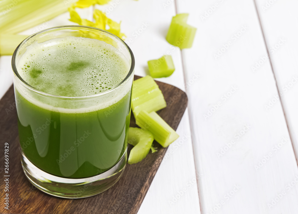 Fototapety, obrazy: Healthy detox celery juice in a glass on the white table