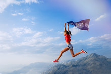 Child Teenager Girl Jumping On The Top Of The Mountain With An European Union Flag On Her Shoulders. Sunset Time