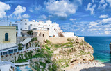 Polignano a Mare - Apulia, Italy. Beautiful aerial view of cityscape and coastline on a beautiful summer day - 266700264
