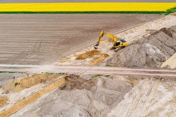 Aerial drone view on excavator working on building site
