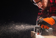 Carpenter Works With Electrical Planer