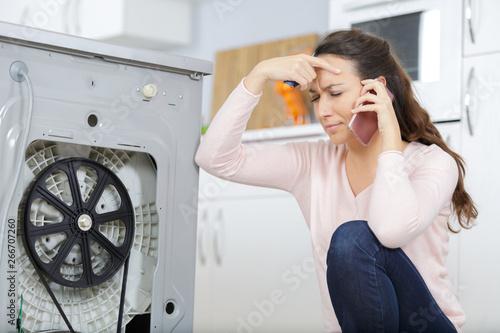 Fotomural woman is calling a plumber to repair the leak