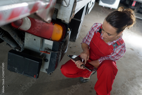 female truck mechanic using tablet pc
