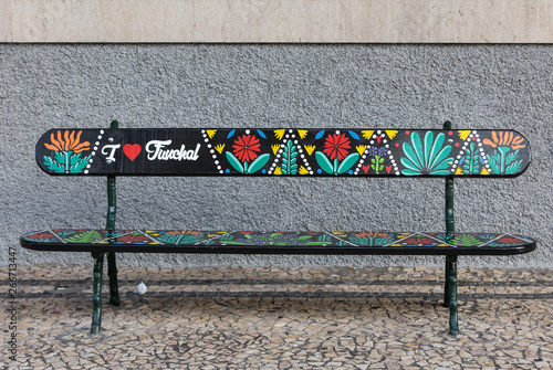Artistically painted wooden bench  on Avenida Arriaga in Funchal. Madeira, Portugal