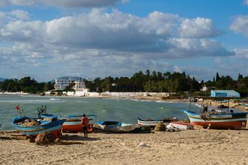 Fototapeta na wymiar Fisherman's boat at beach in Tunisia, Hammamet Tunisia