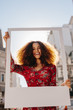 canvas print picture - Beautiful woman holding a blank photo frame