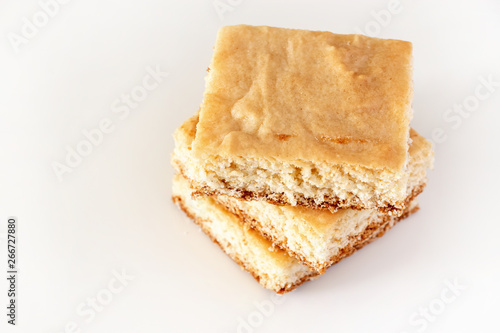 Stack of square pieces lemon shortbread cake isolated white background Wallpaper Mural