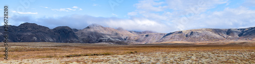 Papel de parede Landscape panoramic panorama view of Laugarvatn mountains with clouds covering o