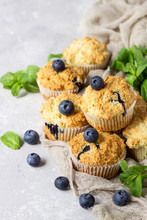 Blueberry Muffins With Fresh Berries And Mint Leaves On Light Grey Stone Background. Copy Space.