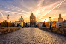 Charles Bridge (Karluv Most) At Sunrise, Scenic View Of The Old Town With Yellow Sun, Colorful Sky And Historic Medieval Architecture, Prague, Czech Republic