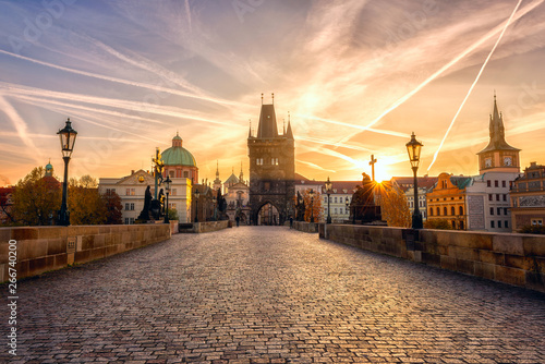 Charles bridge (Karluv most) at sunrise, scenic view of the Old town with yellow Wallpaper Mural
