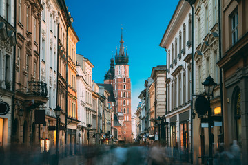 Krakow, Poland. View Of The St. Mary's Basilica From Florian Street. Famous Landmark Old Landmark Church Of Our Lady Assumed Into Heaven. Saint Mary's Church