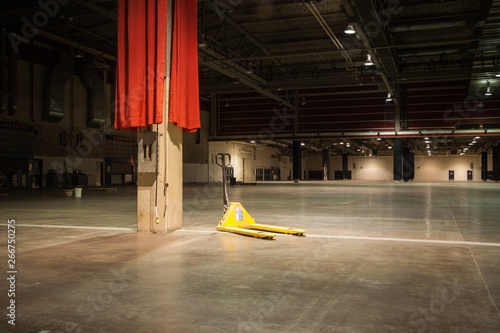 Pallet jack sits in empty convention hall Canvas Print