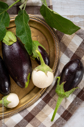 Poster de jardin Nature Fresh black and white eggplants on plate