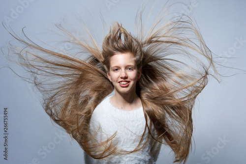 Teen girl with long hair flying in air Canvas-taulu