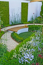 A Heather Garden Showing The Various Applications Including Verticle Gardening In This Versatile Planting In An Urban Garden