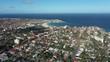 Sydney, Bondi, Australia - March 3, 2019: aerial Dolly shot showing Bondi Beach and suburbs afternoon
